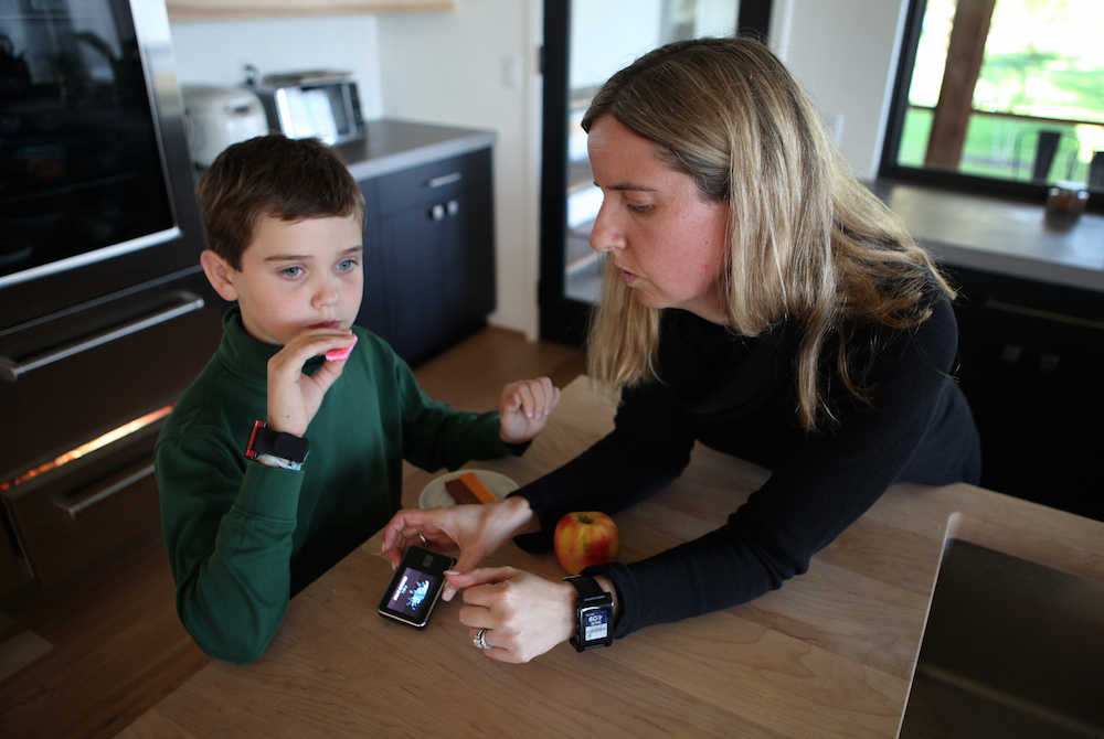 Coburn Dukehart / Wisconsin Center for Investigative Journalism Jack Christensen, 8, has a snack at his home in Waunakee, Wis., after school on Oct. 5, 2016. His mother, Jess Franz-Christensen, logs his carbohydrate intake on a monitoring device. Jack has Type 1 diabetes and his parents wear watches to monitor his blood sugar level 24 hours a day to ensure his numbers are not too high or low. Rapidly rising insulin costs have prompted Franz-Christensen to become a parent activist pushing for lower drug prices.