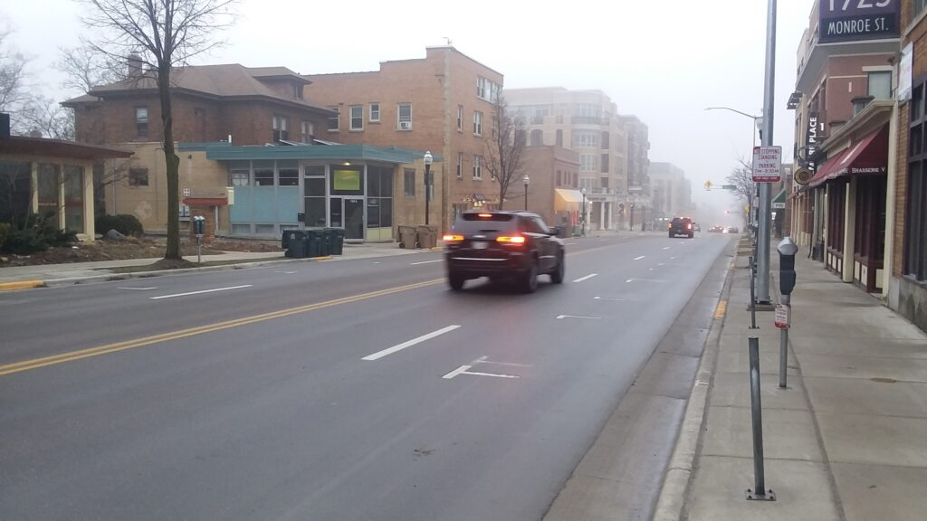 A nearly deserted Monroe Street in Madison during the morning commute on March 19, just after the Safer at Home order was announced. Dan Plutchak/photo.
