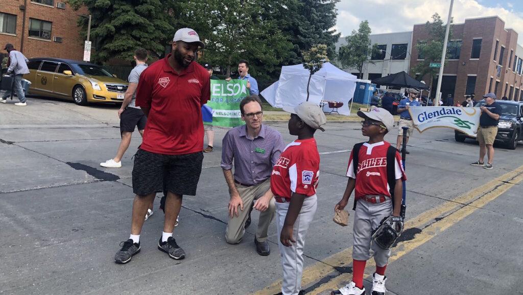 Senate candidate Democrat Tom Nelson greets Juneteenth parade goers Saturday in Milwaukee.