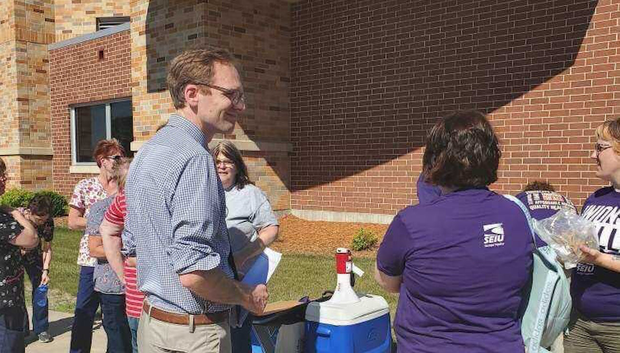 Senate Candidate Tom Nelson rallies with Wisconsin Rapids health care workers on June 16, 2021.